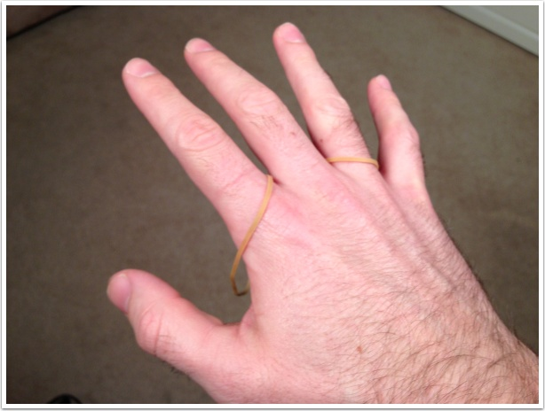 Put a rubber band on your right index finger and your right ring finger