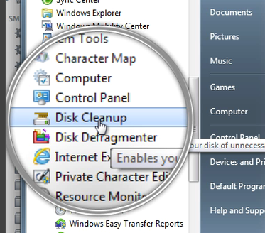 Start Menu> Accessories> System Tools> Disk Cleaner